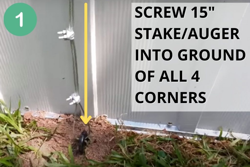 Screw stake/auger into ground of all 4 corners of your chicken coop.