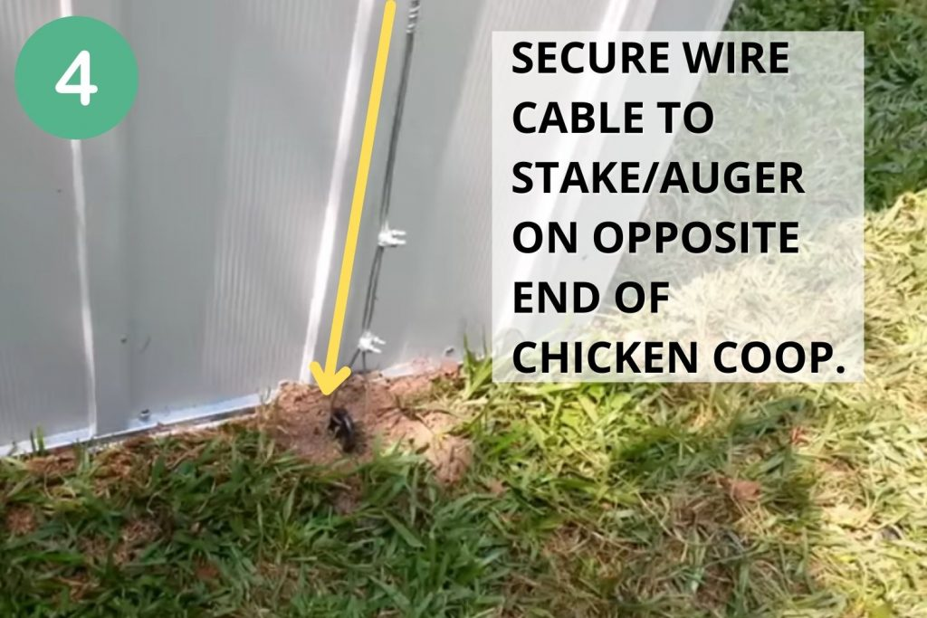 Secure wire cable to stake/auger on opposite end of chicken coop.