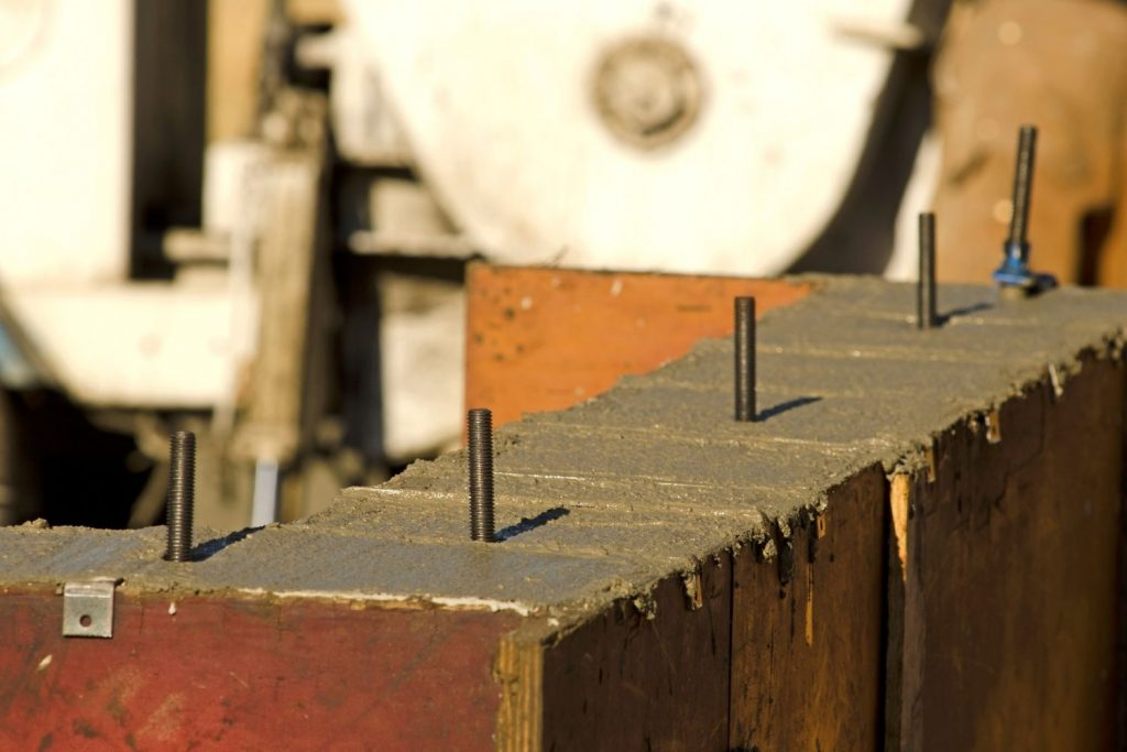 USE ANCHOR BOLTS TO SECURE YOUR NESTING BOXES WHEN BUILDING YOUR CHICKEN COOP.
