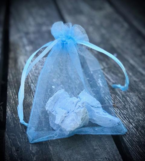 CUT UP IRISH SPRING SOAP AND PLACE PIECES IN A MESH BAG.